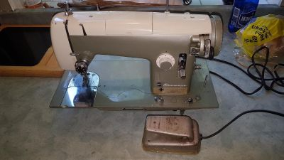 Vintage 1950's Kenmore model 158.521 Sewing Machine with manual and Accessories, works