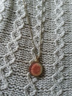 Gold chain necklace with rose accent