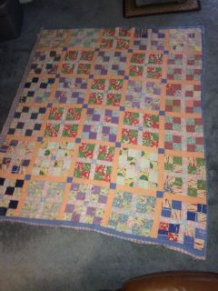 Vintage quilt could use as is or for projects. Has several spots like one shown