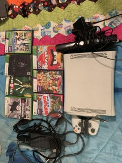 Xbox 360 with Kinect 1 controller and 7 games.