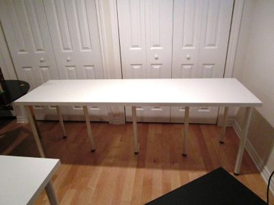 Long white table - ideal for studying or parties! In like new condition.