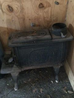 $200, Logwood 1261 Cast Iron Stove, plus smoke stack pipes