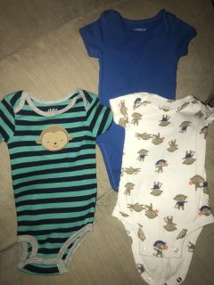 Set of three Carter s size 6-12m onesies two with monkeys, one solid blue