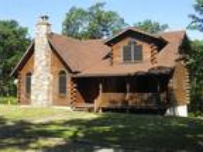 Stunning Secluded Log Cabin on 7.91 acres ready for your family get-a-way!