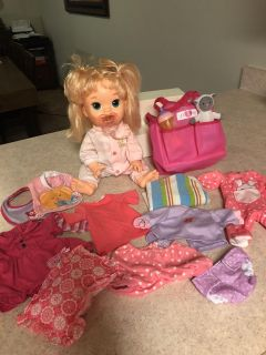 Baby Alive- diaper bag and clothes.