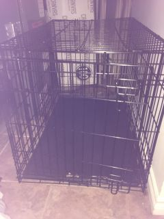 Dog crate with slide out tray