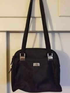 Black purse with multiple zippered sections by Unlisted