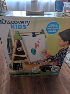 Discovery kids tabletop easel + extra rolls of paper.