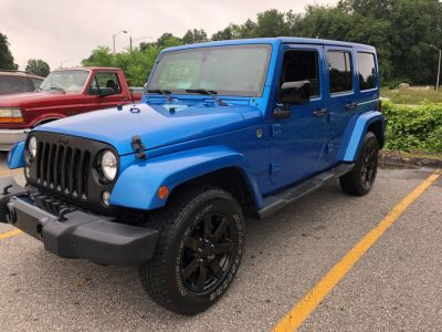 2014 Jeep Wrangler Unlimited Sahara (Ampd)