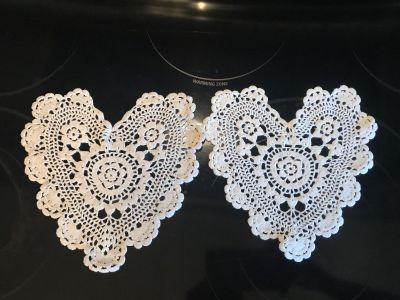 2 heart doilies one is beige one is white. One price