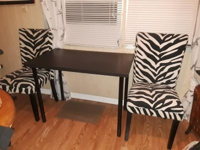 Two leopard print chairs $5.00 each or $8.00 for both