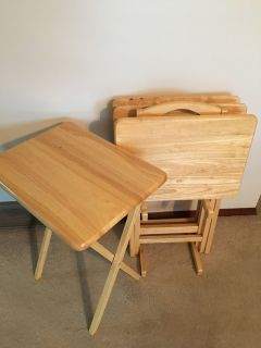 TV tray set. 4 trays with storage stand. 15 x 18 . Excellent condition!