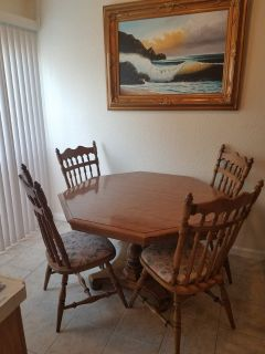 Dinning table comes with 4 leaves and 6 chairs