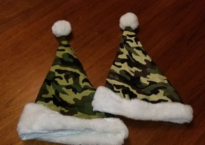 Two camo hats for dogs
