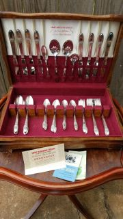 Mid Century Silverplate Serviceware by Rogers Bros. Originally an 8 place setting. 4 salad forks are missing but can be replaced. As is.