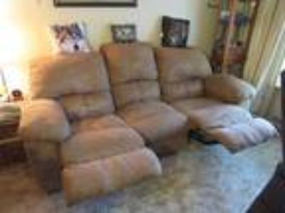 Sofa with recliner in each end