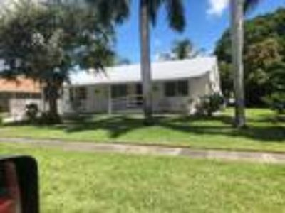 Located 1 1/2 miles from beach. Large yard. Washer and dryer. Refrigerator