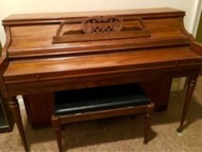 Piano with storage seat