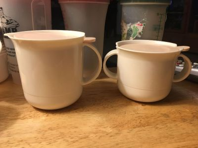 Vintage Tupperware Creamer And Sugar Set with tops.