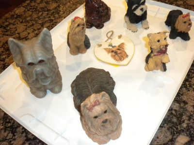 Collection of Yorkie figurines and magnets