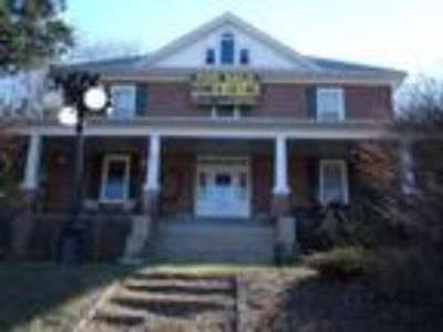 Large historic brick home on 1.65 acres