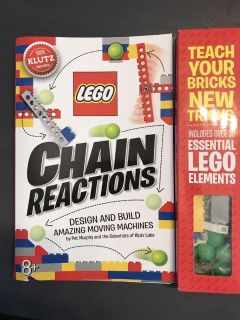 LEGO chain reactions book with pieces. Never opened.