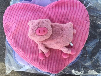 Large heart shaped floor pillow and stuffed pig