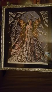 Puzzle picture in silver frame