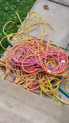 100's of feet if Extension cords