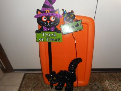 Halloween signs and black cat decorations