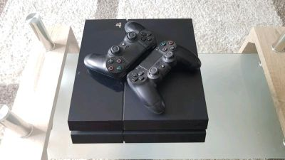 500GB PS4 with 2 controllers and 3 games