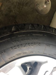 P265/65R18 Tires and aluminum alloy wheels from a Chevy Silverado. Three tires are good (one has a screw in the sidewall). Sensors work!