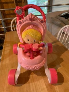 Baby stroller with plush doll