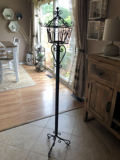 Lantern on a stand. Indoor or outdoor. Perfect to put a citronella candle in outside ok patio