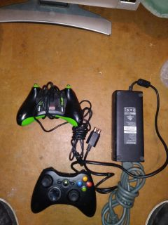 2 Xbox 360 controllers one is a custom controller and extra charge cord