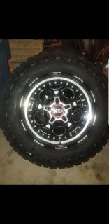 KMC XD 837 demodog wheels and Nitto 285 65 20 tires.