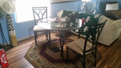 Glass top table with 4 chairs
