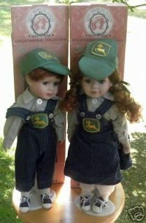 Porcelain John deere boy and girl dolls. Both come in original boxes. Excellent condition.
