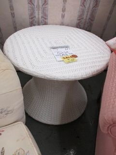 "Round Plastic ""Rattan"" Table by Front Gate"
