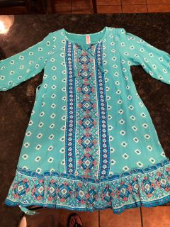 Justice NWT vibrant teal dress. 3/4 length sleeves with cut out. Beautiful colors. Very light weight. SF. Size 10. $7.