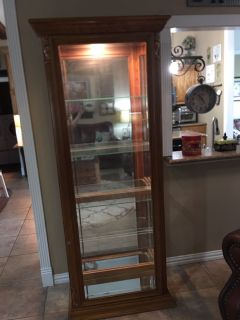 28 x 13 x 78 lighted oak curio cabinet. Excellent condition. $50