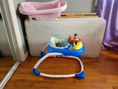 Baby bed with matress,walker and baby bath tub.