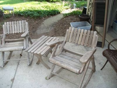 SET OF OUT DOOR ROCKERS AND A SMALL TABLE