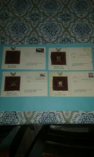 Collection of (4) 22kt Gold COVER STAMP