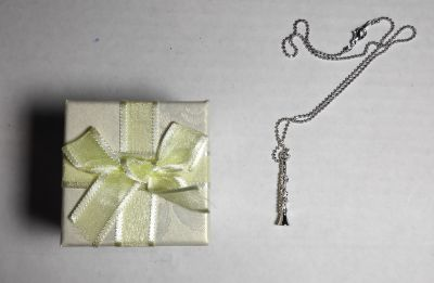 Necklace with clarinet pendant