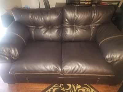 Brand new Expresso leather love seat