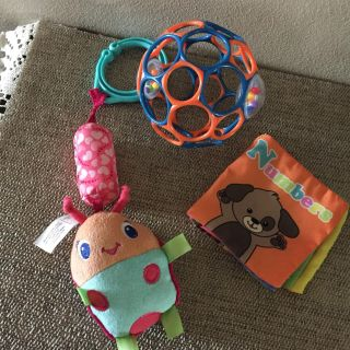 GROUP OF BABY TOYS, O Ball, crunchy book, and hanging rattle
