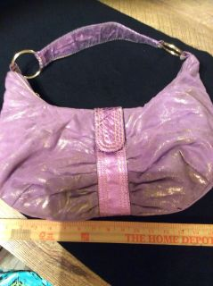 Hobo style purse zipper top with snap over tab soft and shiny