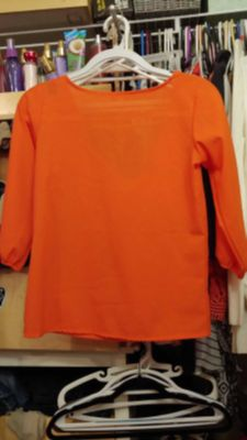 Orange dress shirt with bow on the back