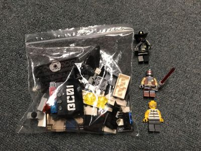 Lego Police Set. 2 good guys 1 bad guy included. Do not have instructions
